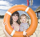 Happy family with life buoy. — Stock Photo