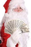 Santa Claus holding money. — Foto de Stock
