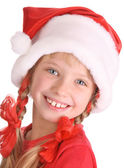 Smiling girl in hat of santa claus. — Stock Photo