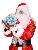 Santa Claus giving gift box. — Stock Photo