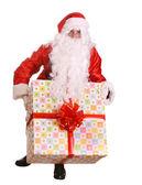 Santa Claus giving big gift box — Stock Photo