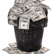 A money is in a trash bucket. - Zdjcie stockowe