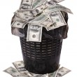 A money is in a trash bucket. - Stock Photo