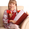 Girl sit in armchair and read book. — Stock Photo #1050502