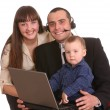Happy family with laptop and headset. — Stok fotoğraf