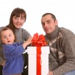 Stock Photo: Happy family with white gift box.