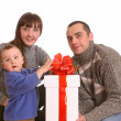Happy family with white gift box. — Stock Photo