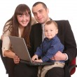 Happy family with laptop sit on chair. — Stock Photo
