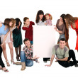 Baby and big group with banner. — Stock Photo
