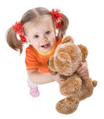 Girl in orange with toy. — Stock Photo