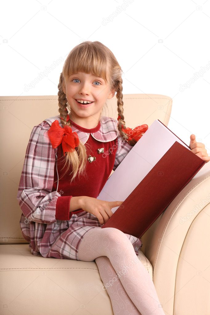 Girl sit in armchair and read book stock photo for Sitting in armchair
