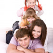 Happy family on white bed. — Stock Photo #1334028