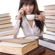 Girl with heap book and  cup, - Stock Photo