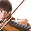 Stock Photo: Aggressive young girl with fiddle.
