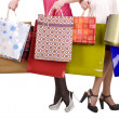 Shopping bag and group of leg in shoes. - Stock Photo