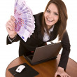 Businesswomen with money and laptop. — Stockfoto