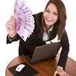 Businesswomen with money and laptop. — Stock Photo