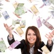 Business women with flying money. — Stockfoto