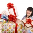 Beautiful girl with group of gift box. — Stock Photo #1336432