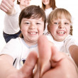 Happy family throw out thumb. — Stock Photo #1336516