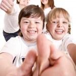 Happy family throw out thumb. — Stock Photo