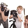 Happy family with three camera. — Stock Photo