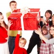 Stock Photo: Happy family with red gift box.