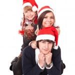 mutlu bir aile ile Noel Baba şapkası, çocuk — Stok fotoğraf