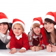 Happy family with children in santa hat - Stock Photo