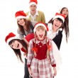 Happy group in santa hat. — Stock Photo