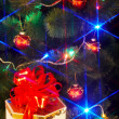 Royalty-Free Stock Photo: Christmas tree with flash and  gift box.