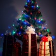 Christmas tree with flash and gift box - Stock Photo