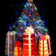 Christmas tree with flash and gift box. — 图库照片