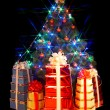 Christmas tree with flash and gift box. — Stock Photo #1337296