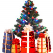 Christmas tree with light and gift box. — Stock Photo #1337315