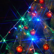 Christmas  tree with light and flash. — Stock Photo