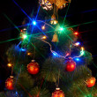 Christmas tree with flash and bell. - Zdjcie stockowe