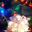 Christmas tree with flash and gift box. — Stock Photo #1337445