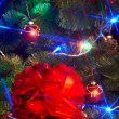 Christmas tree with flash and gift box. — Stock Photo #1337456