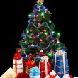 Christmas tree with light and gift box. - Stock Photo