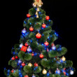 Christmas tree with light and blue star. — Zdjęcie stockowe