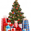 Foto Stock: Christmas tree and group gift box.