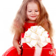 Girl child in red dress with gift box. — Stock Photo #1337758
