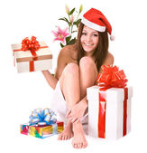 Christmas girl in santa hat, gift box — Stock Photo