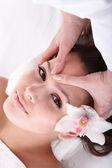 Girl and beautician. Facial massage. — Stock Photo