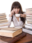 Girl with heap book and cup, — Stock Photo