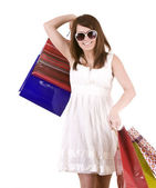 Girl in glasses with gift bag shopping. — Stock Photo