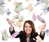 Business women with flying money. — Stock Photo