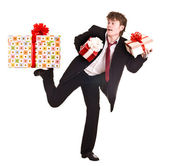 Man with falling gift box run. — Stock Photo