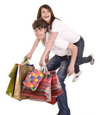 Couple in blue jeans shopping. — Stock Photo